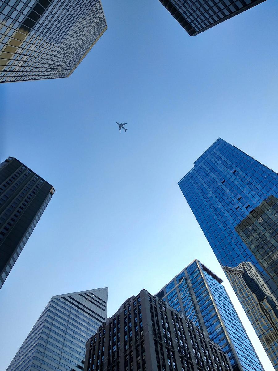 Airplane flying over buildings