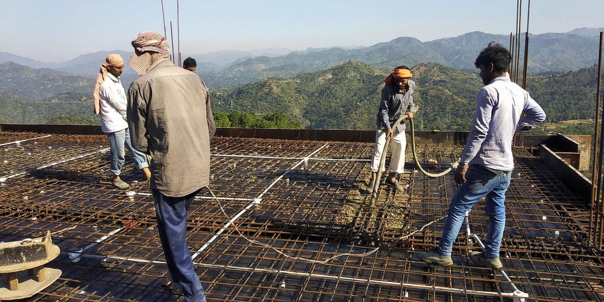 Labourers working on slab